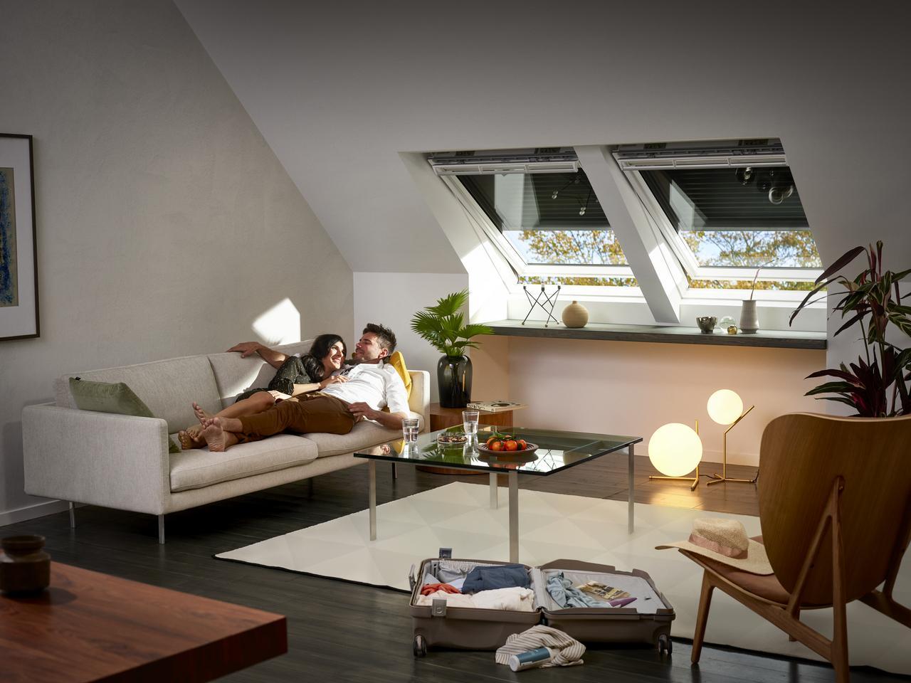Дизайн інтер'єру спальної кімнати на мансардному поверсі: фото #0016 Фото мансардних будинків зсередини